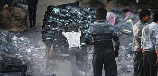 e-waste being gathered up by children